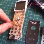 An open view of the KX-TGA450b model phone showing the keypad and DIY repair kit